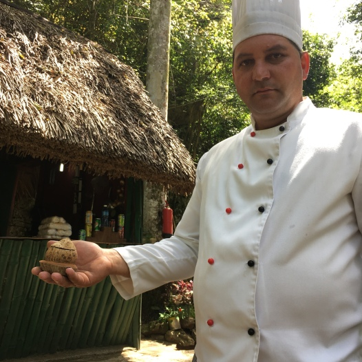 Chef at the outdoor bar and grill shows the coconut coffee cups